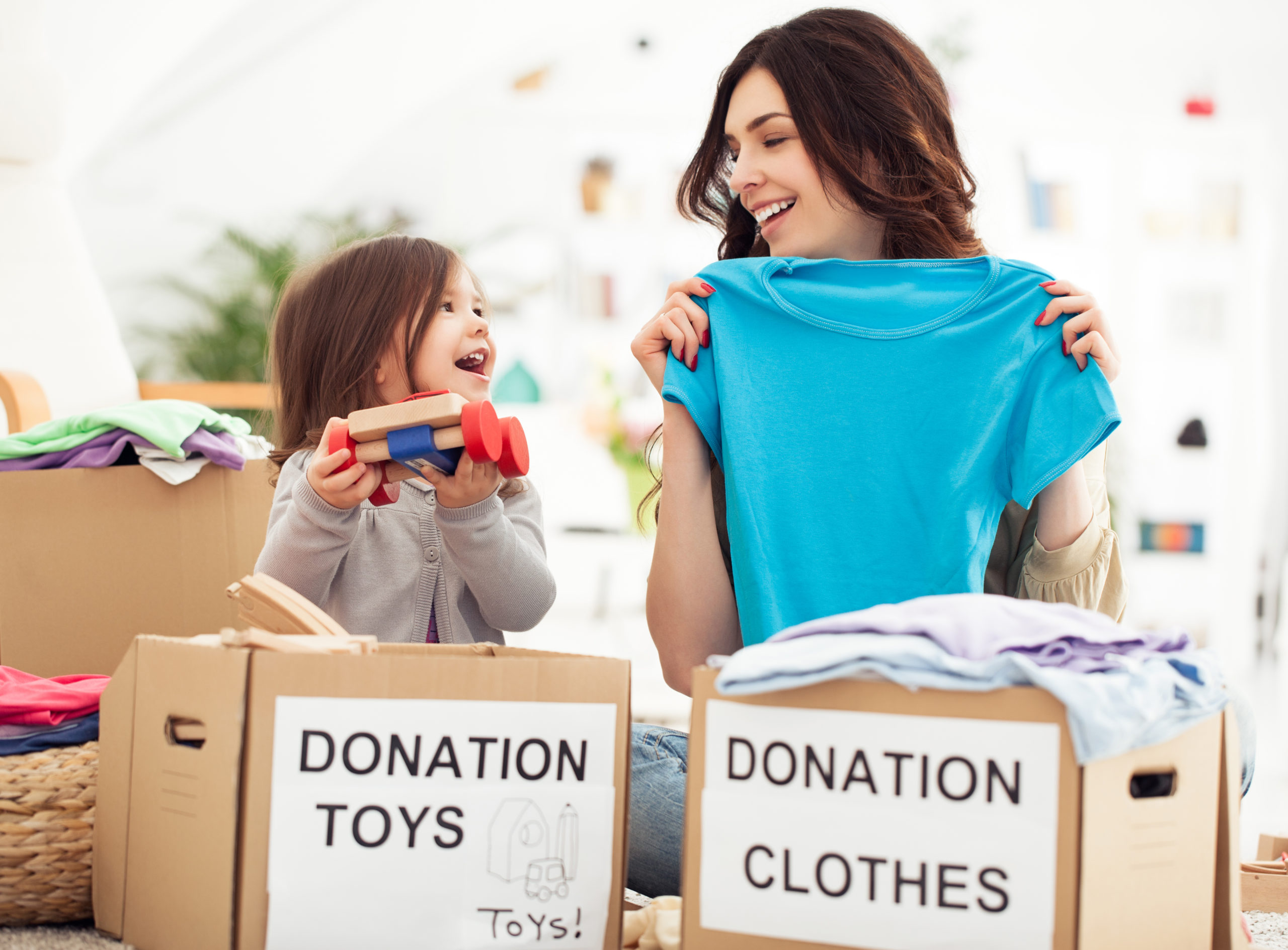 woman and child sorting donations