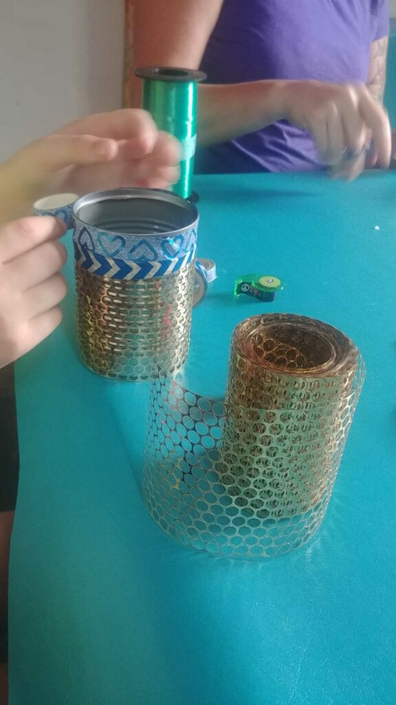 Image of can wrapped in decoration